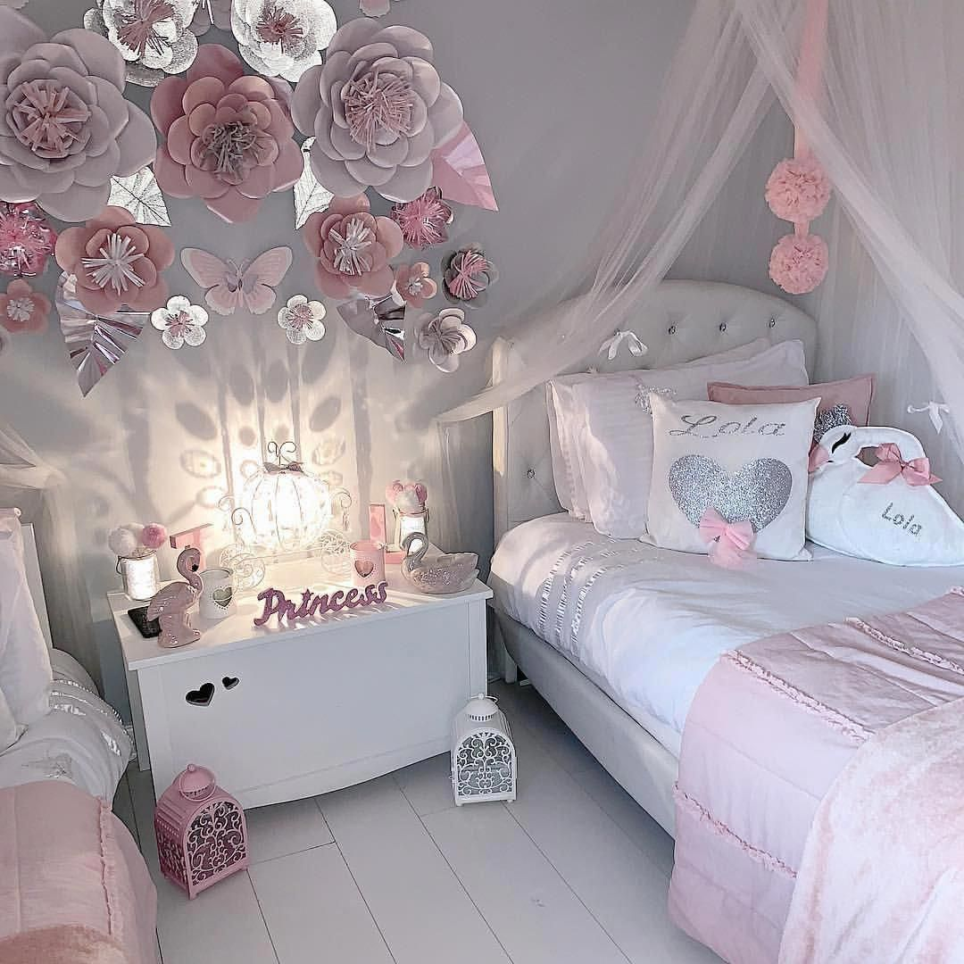 Pretty grey and pink girls bedroom with beautiful paper flowers on