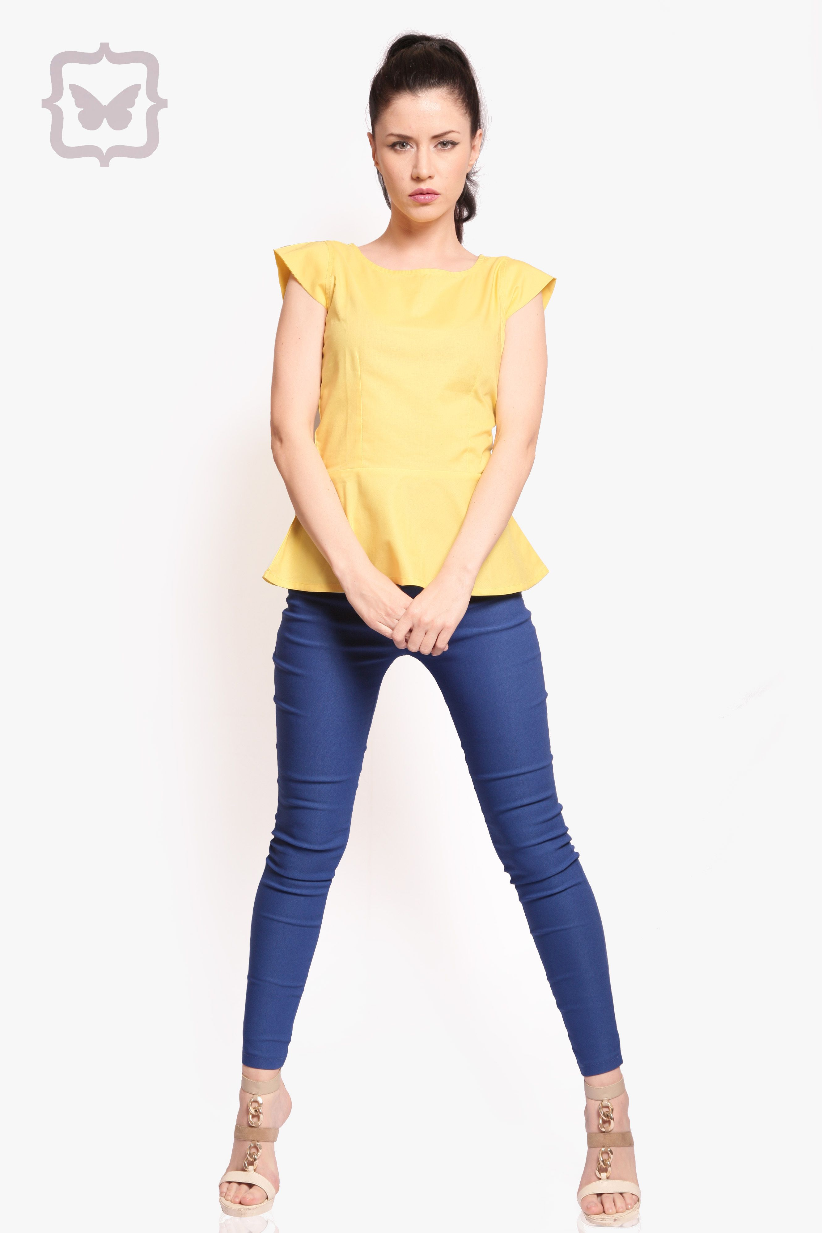 4828ec93fe477 A lemon yellow peplum top paired with electric blue jeggings. In color  block heaven!