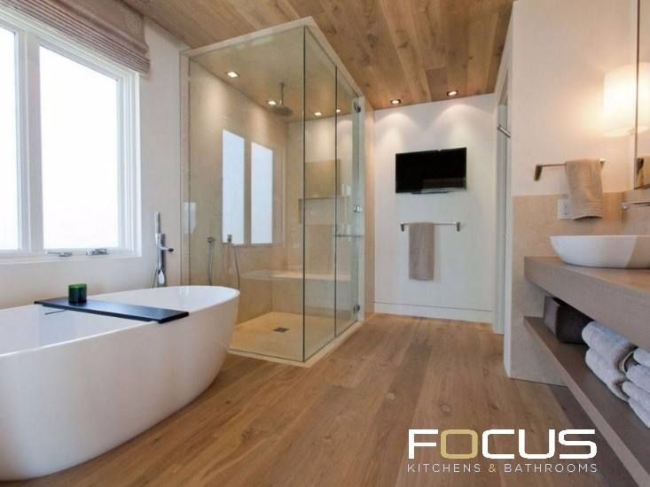 Luxurious Bathroom.   Features timber flooring/roof, freestanding bathtub, double basins and a wall-mounted television.