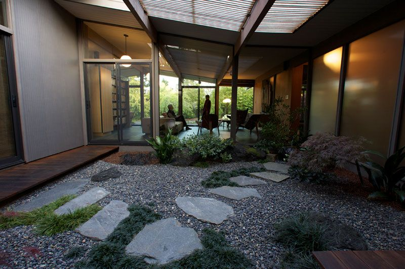 Originally this atrium area was almost completely covered with a concrete patio, there was no engawa (deck on the left) and only minimal planting. In January 2001 we removed the concrete and built this Japanese tsubo (courtyard) style garden.