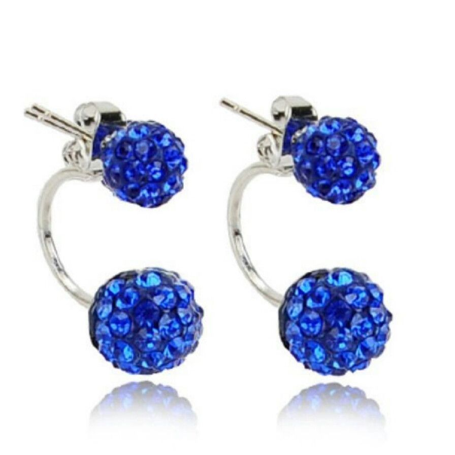 Double sided disco ball earrings in blue. Material is zinc alloy and crystals…