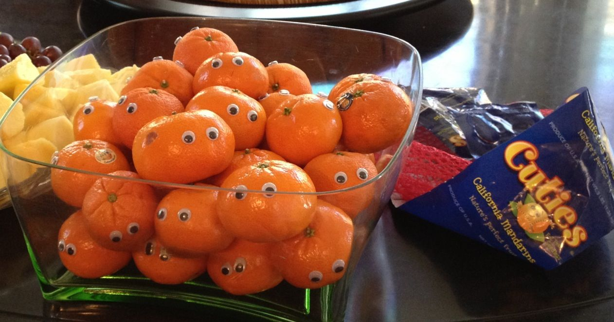 Clementines with google eyes. A healthy sports team snack