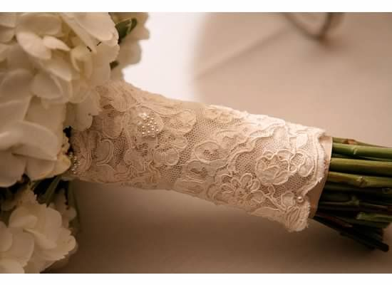 lace from mom's dress wrapped around the bouquet
