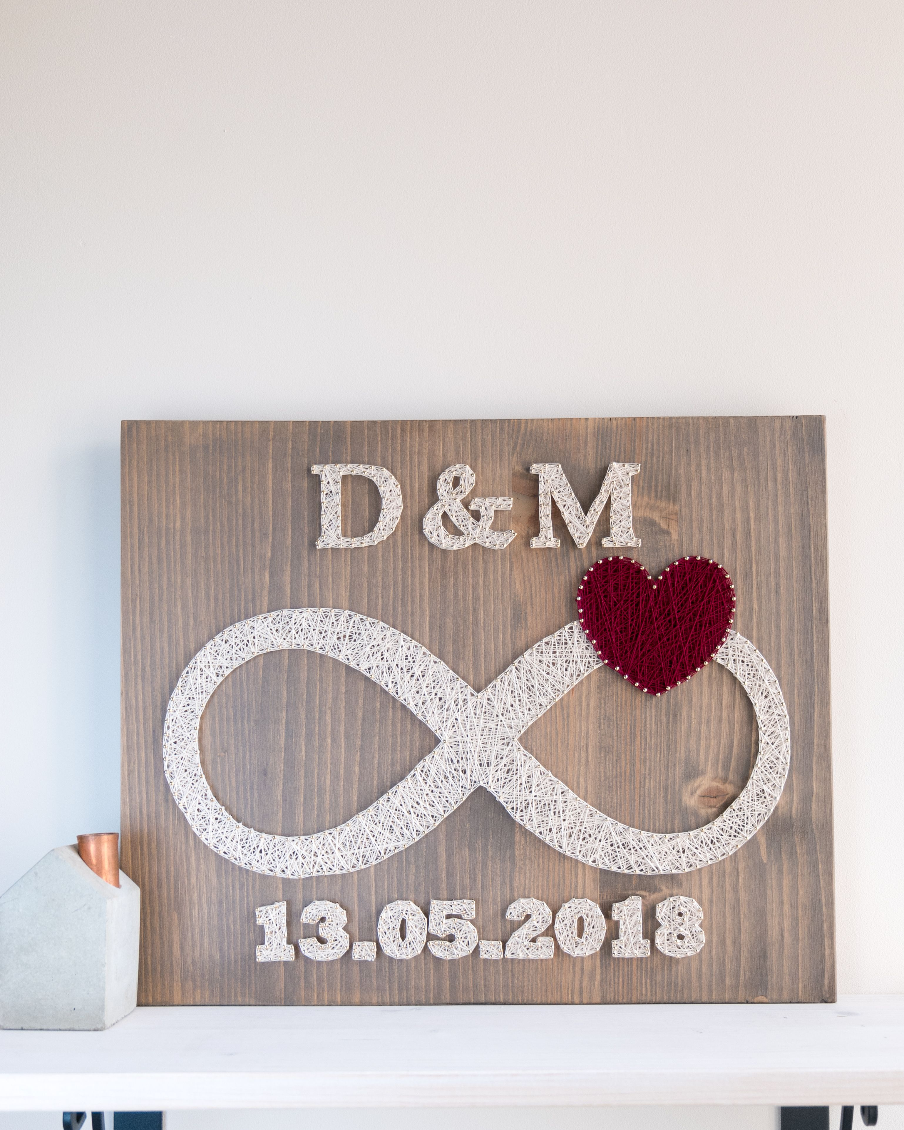 Infinity string art decor with custom dates and red heart decor. Put your (or your friends) special dates on your wall with style :) Made with high quality golden nails and threads which makes finished product more elegant and sophisticated.