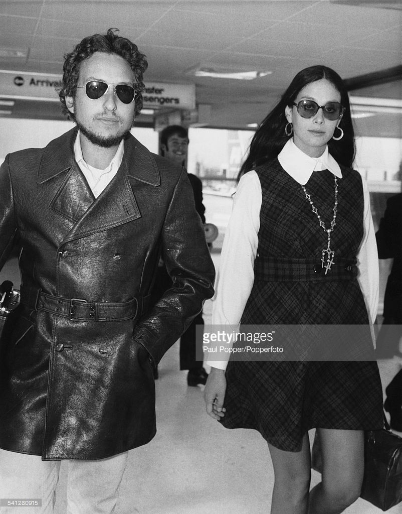 1969 Bob Dylan with his wife, Sara Lownds at Heathrow Airport, London, 2nd September 1969. The couple are returning to the US following Dylan's appearance at the Isle of Wight festival.
