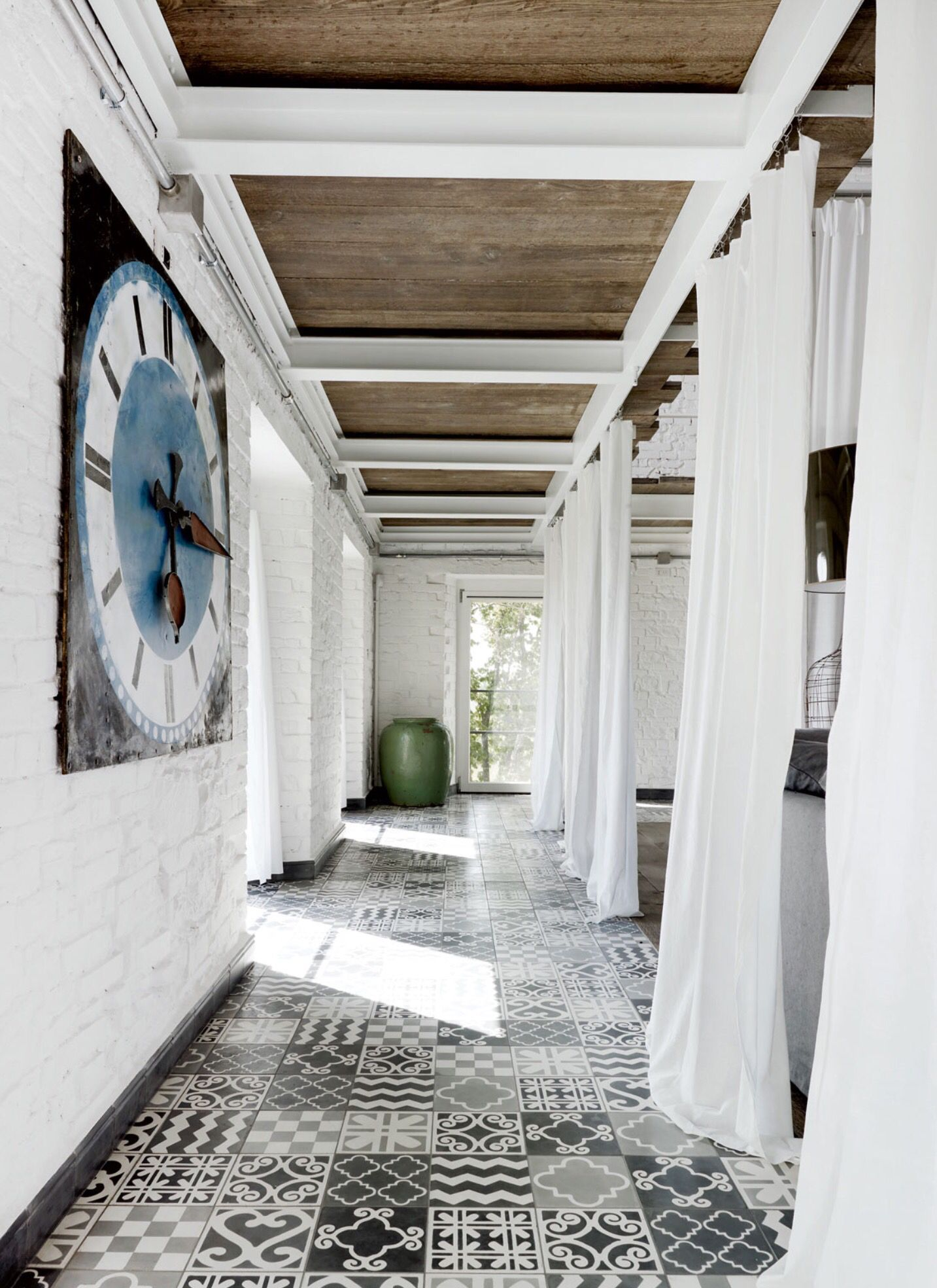 Paola navone umbrian home kateyoungdesigntumblr inside patchwork cement tiles a carpet of custom tile created by paola navone punctuates a corridor on the first floor of a italian farmhouse she renovated doublecrazyfo Images