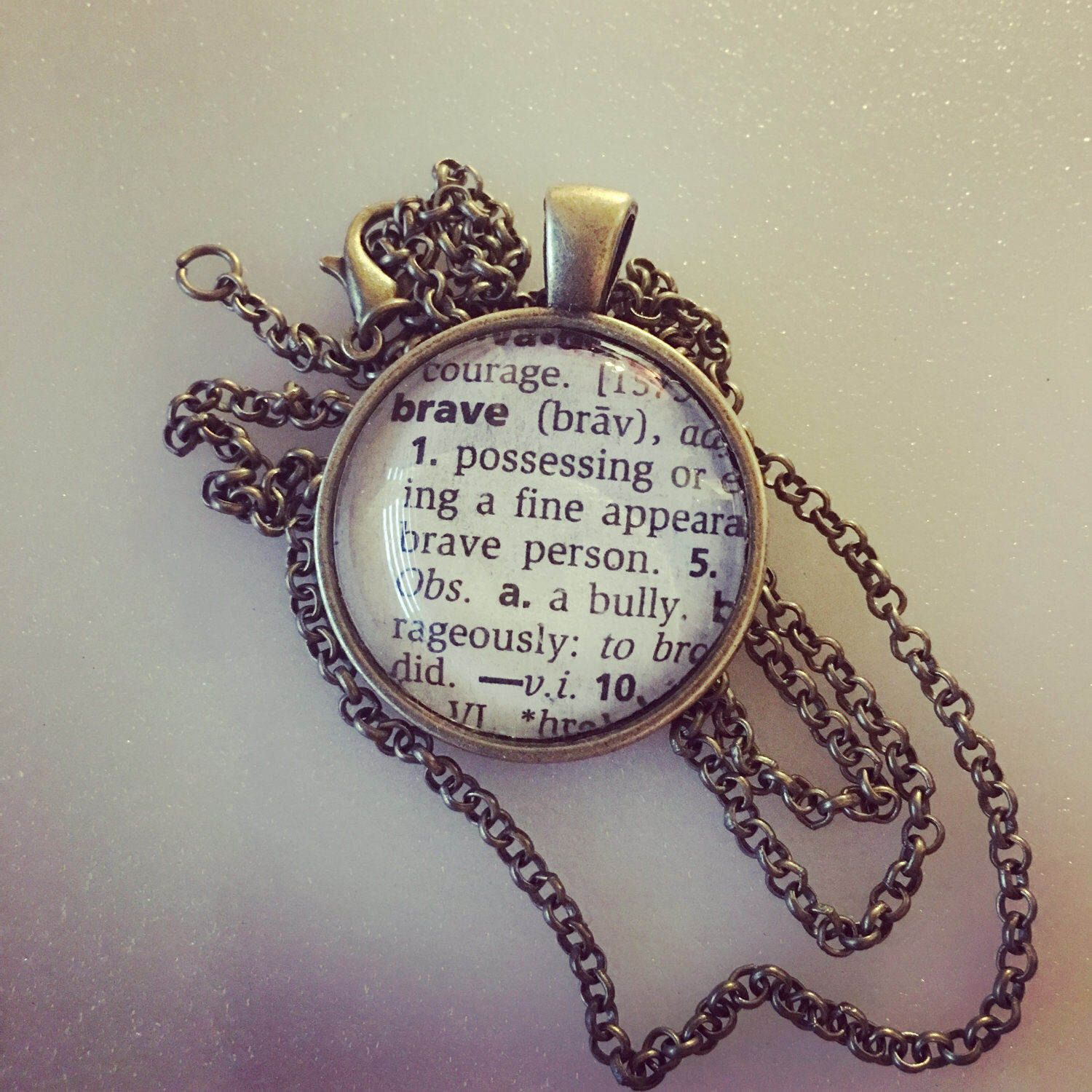 Definition pendant brave 1 round 24 chain vintage bronze brave handmade an inspirational definition pendant for you or to encourage a friend or loved one round vintage bronze and glass chain leadnickel free mozeypictures Gallery