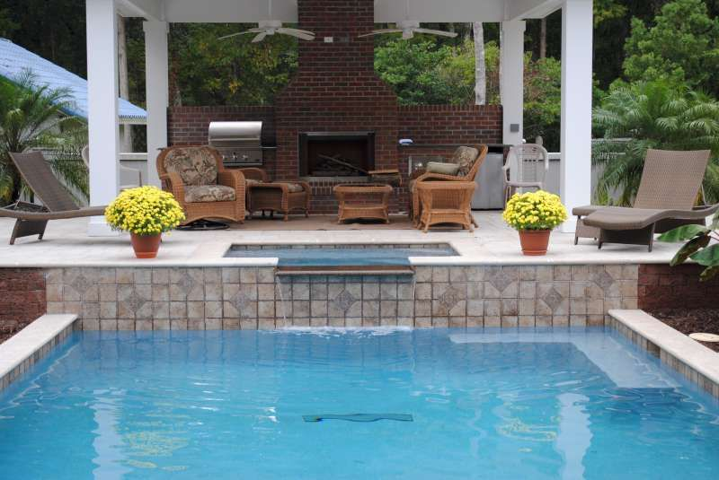 Outdoor living area by swimming pool and spa in ... on Outdoor Living Pool And Spa id=89093
