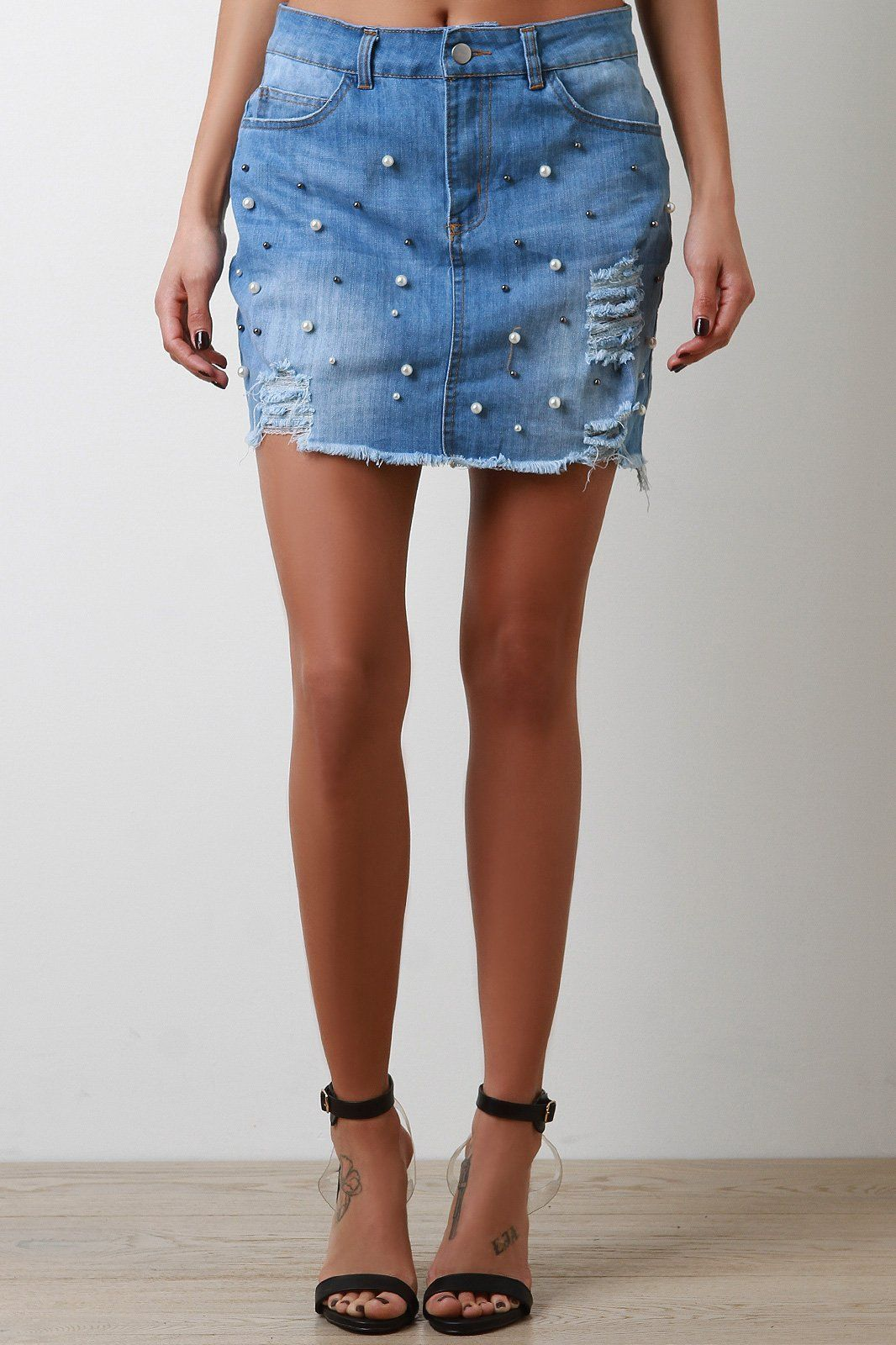 7d7081a51a This adorable high waisted denim skirt features faux pearl accents, raw cut  mini length hem