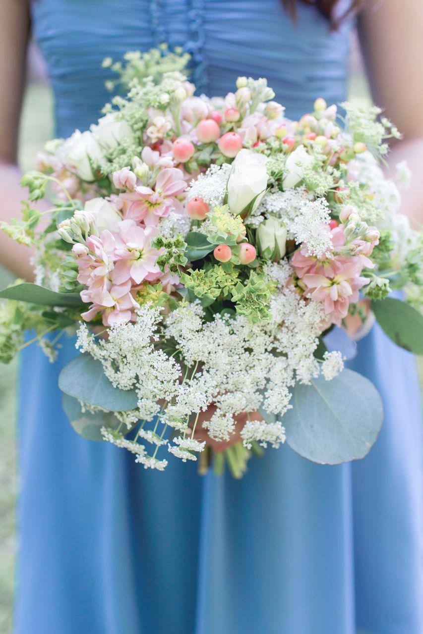 Bridesmaid flowers Blue bridesmaids dresses Wild