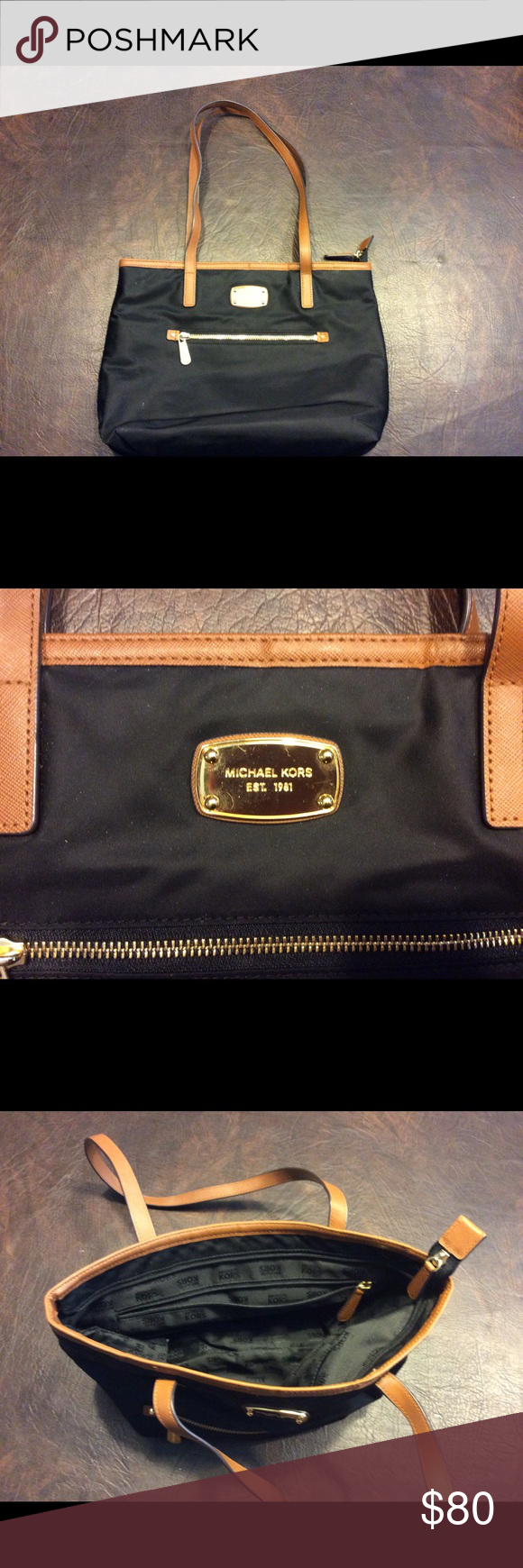 MICHAEL MICHAEL KORS Tote Black tote with brown leather trim strips and zippered pouch and front measures 14 inches 10 height#1152 KORS Michael Kors Bags