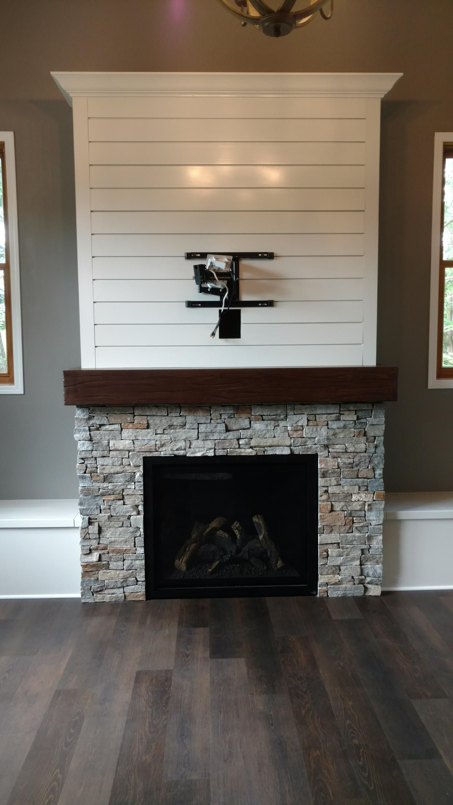 Great american fireplace built this full wall fireplace surround with kozy heat bayport fireplace greystone gold estate stone and custom wood work from