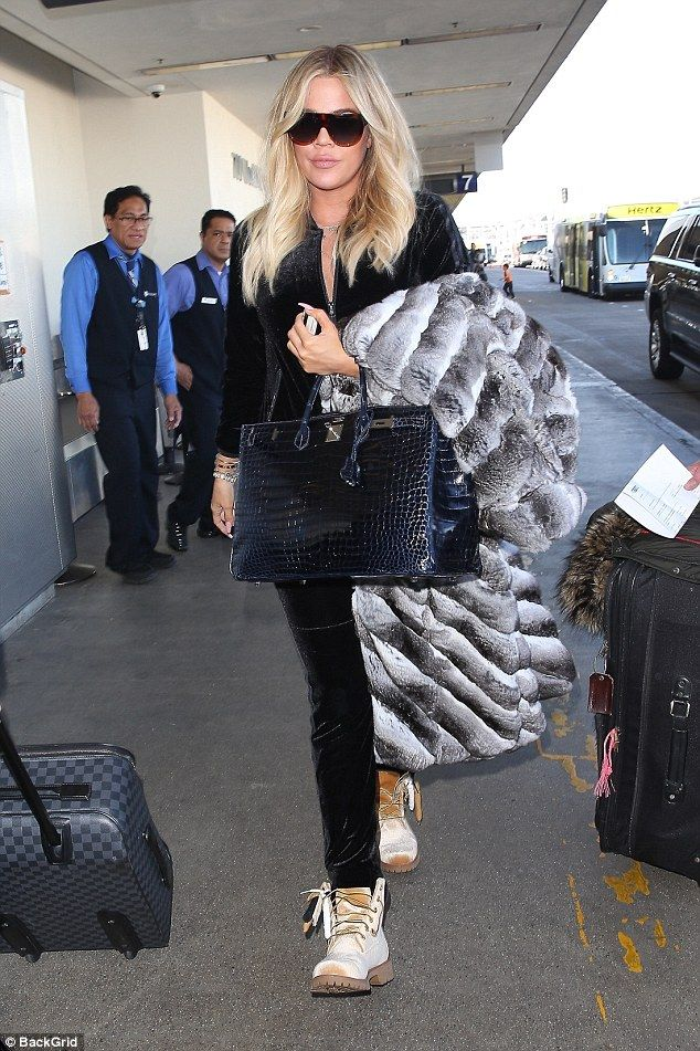 2c7d6c83cb46 Khloe Kardashian was seen arriving at LAX Airport in Los Angeles on Friday  as she kept her burgeoning baby belly under wraps
