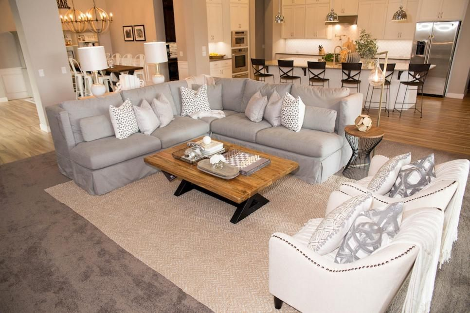 A Neutral Rug Was Layered On Top Of The Carpeting To Give A Cozier Intimate Feel To Transitional Living Rooms Living Room Furniture Layout Living Room Carpet #rug #on #top #of #carpet #living #room