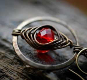 wire wrapping with a bead inside of a hammered hoop.  Would love to see a whole necklace like this. by sally tb