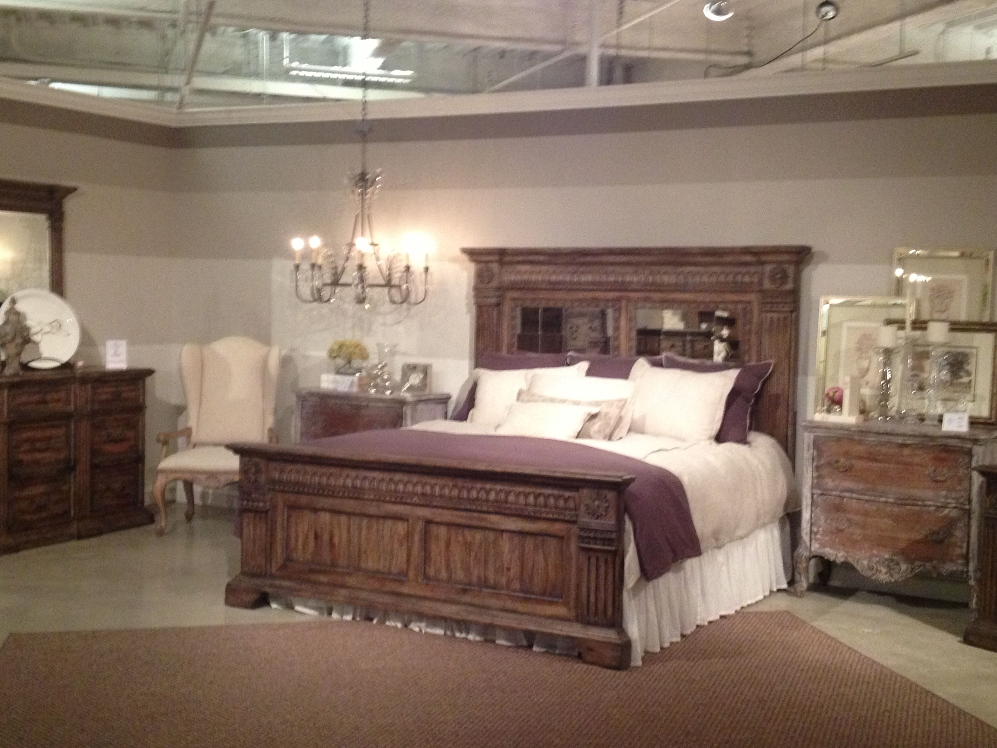 The rustic wood with mirrored headboard makes for a ...
