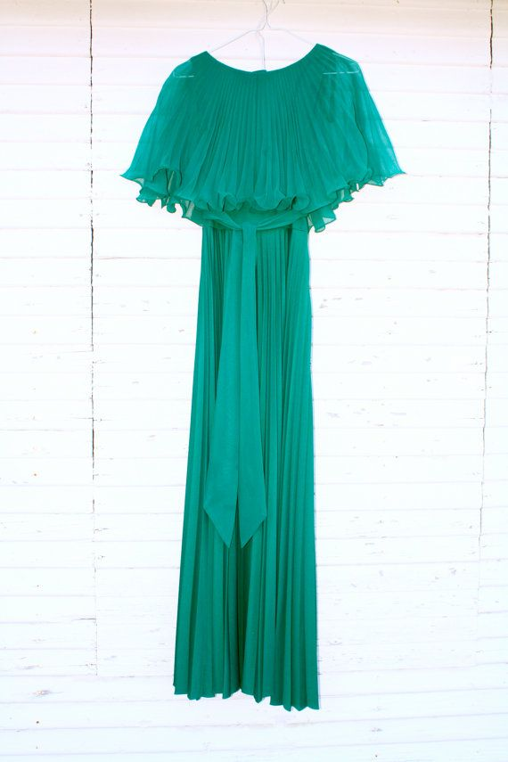 eb56d2eaa3d33 70s vintage emerald green gown with ruffled capelet, flattering empire waist,  sash and accordion pleated floor-length polyester skirt.