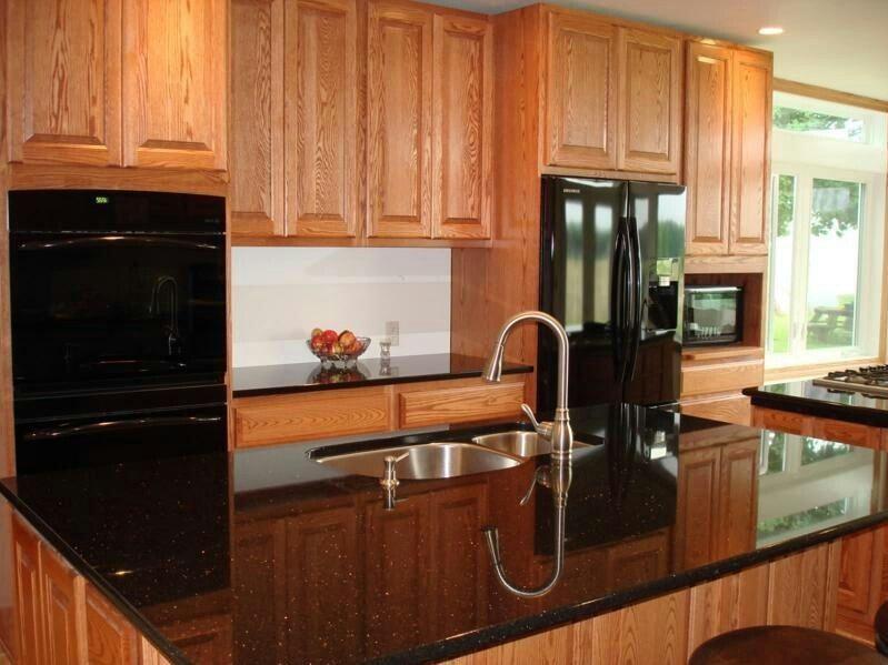 maple cabinets black granite black appliances with