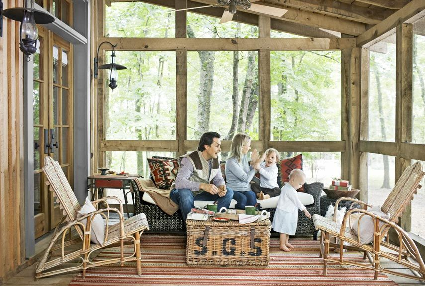 A Wooded Tennessee Retreat Tennessee cabins Wicker sofa and Porch