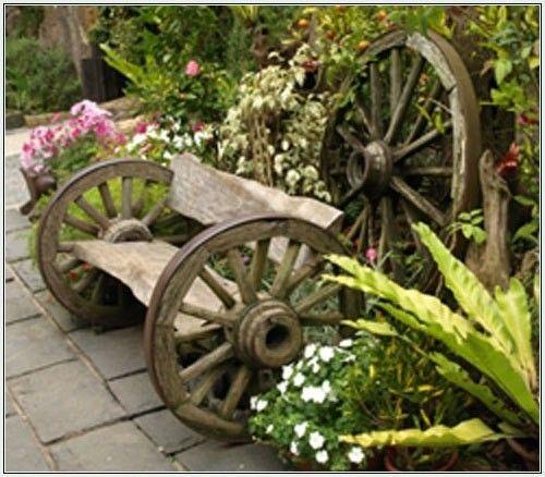 Beautiful Rustic Wagon Wheel Bench In A Garden Retreat