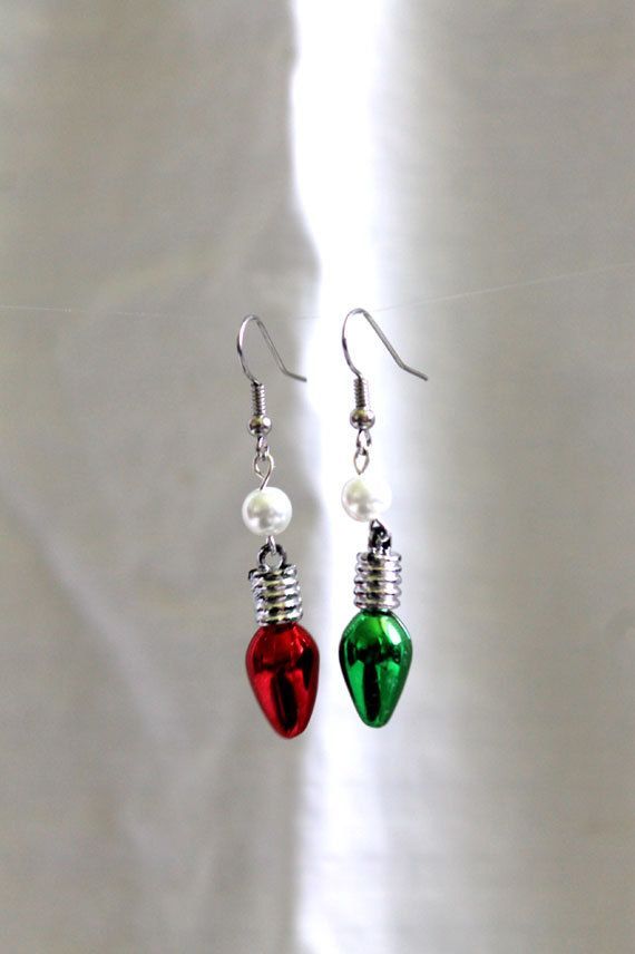 """Handmade Christmas Dangle Earrings by NookCove on Etsy, $5.85  Handmade Christmas Dangle Earrings--features miniature red and green light bulbs with a spacer and a pearl beneath the fishhook ear wire. The earrings measure 2"""" in length."""