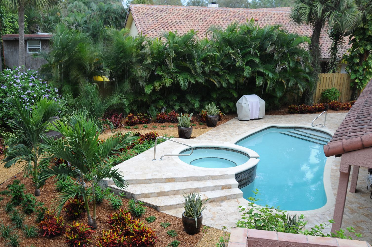 This Boca Raton Florida Pool Area Is Landscaped With