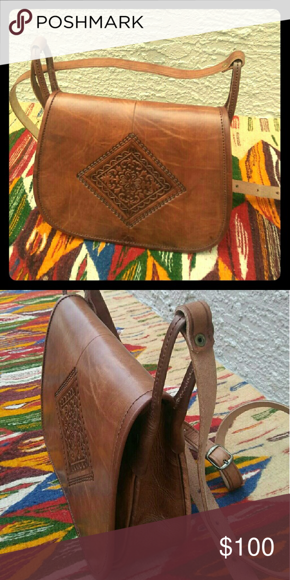Moroccan leather bag Handmade 100% Moroccan leather bag. Purchased in the souks of Marrakesh. Hand tooled. Can be worn as both a shoulder and crossbody bag. Brand new. Bags Crossbody Bags