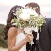 That is a super cute picture too, kissing behind the bouquet.