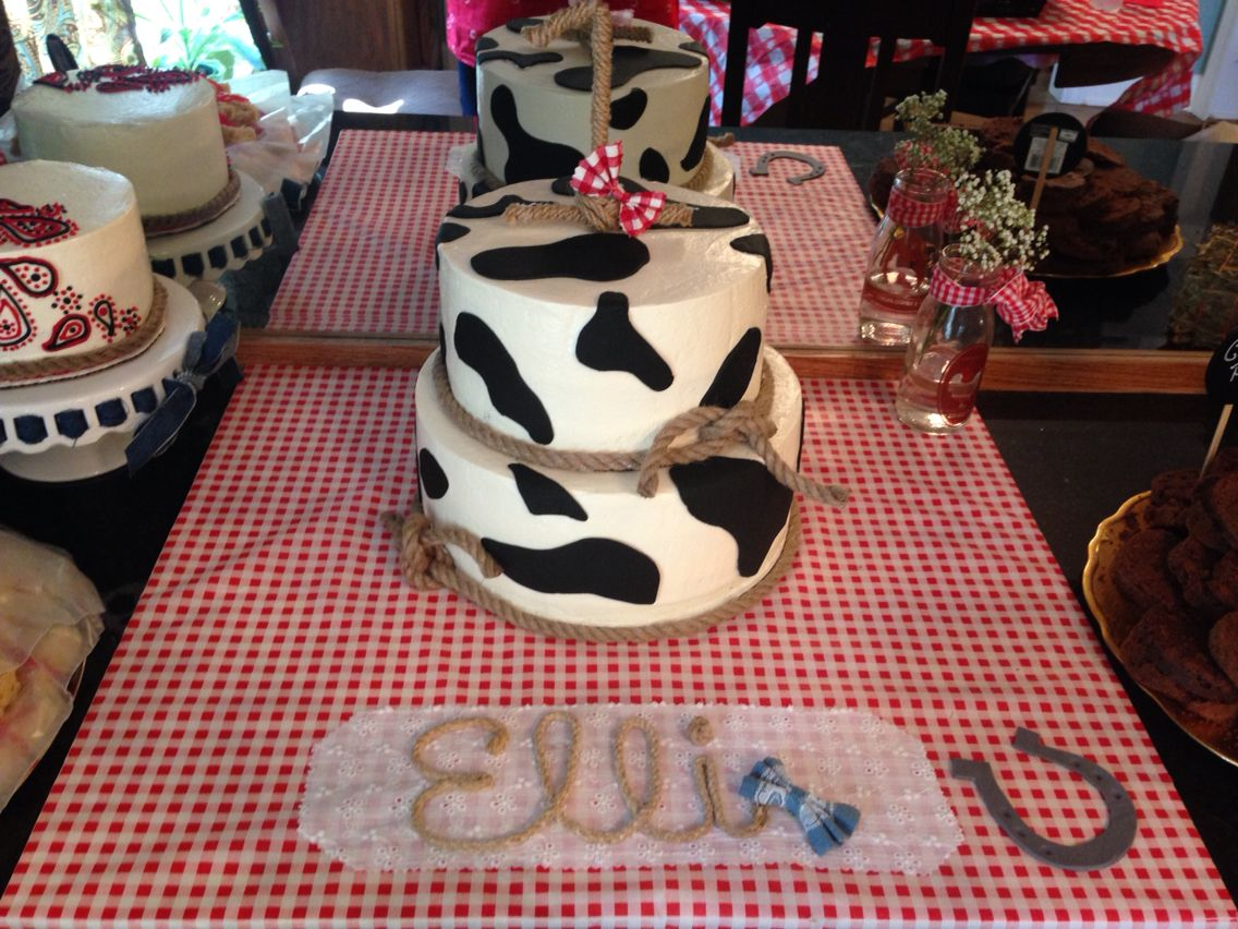 Cow print western first birthday cake