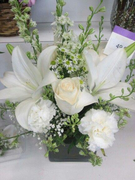 White Roses Casablanca Lilies Make An Elegant Flower Arrangement Flower Arrangements Elegant Flowers Wedding Centerpieces