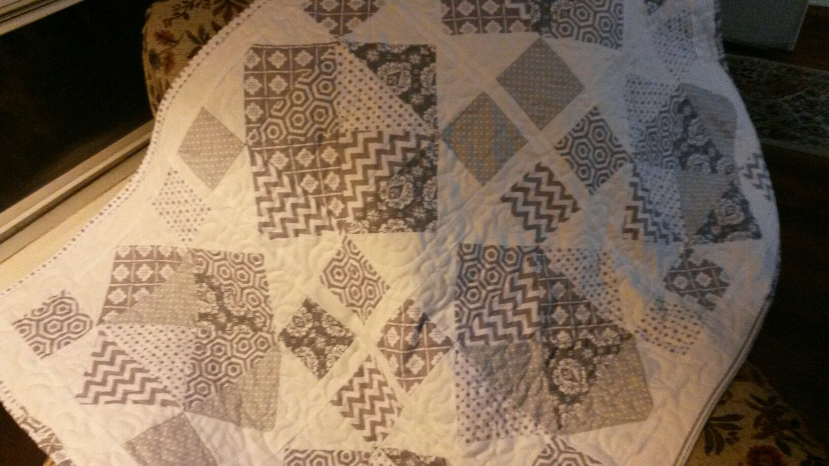 Baby quilt in gray and white.