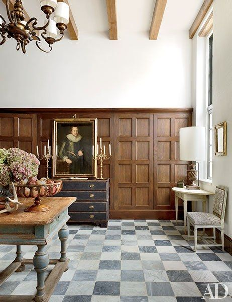 The entrance area is paved with marble tile from Paris Ceramics | archdigest.com