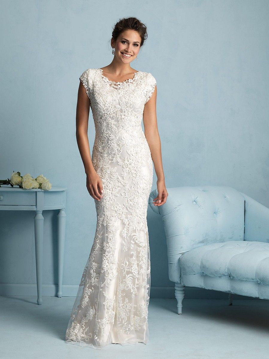 Lace curtains the satin lining of Allure Bridals Modest