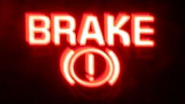 Brake Warning Light On (not to be confused with the ABS or anti-lock warning light) will light up when one of the following occurs: 1. Parking brake cable doesn't completely release (or the parking brake mechanism doesn't fully disengage). 2. Loss of brake fluid 3. Hydraulic pressure imbalance in the master cylinder.