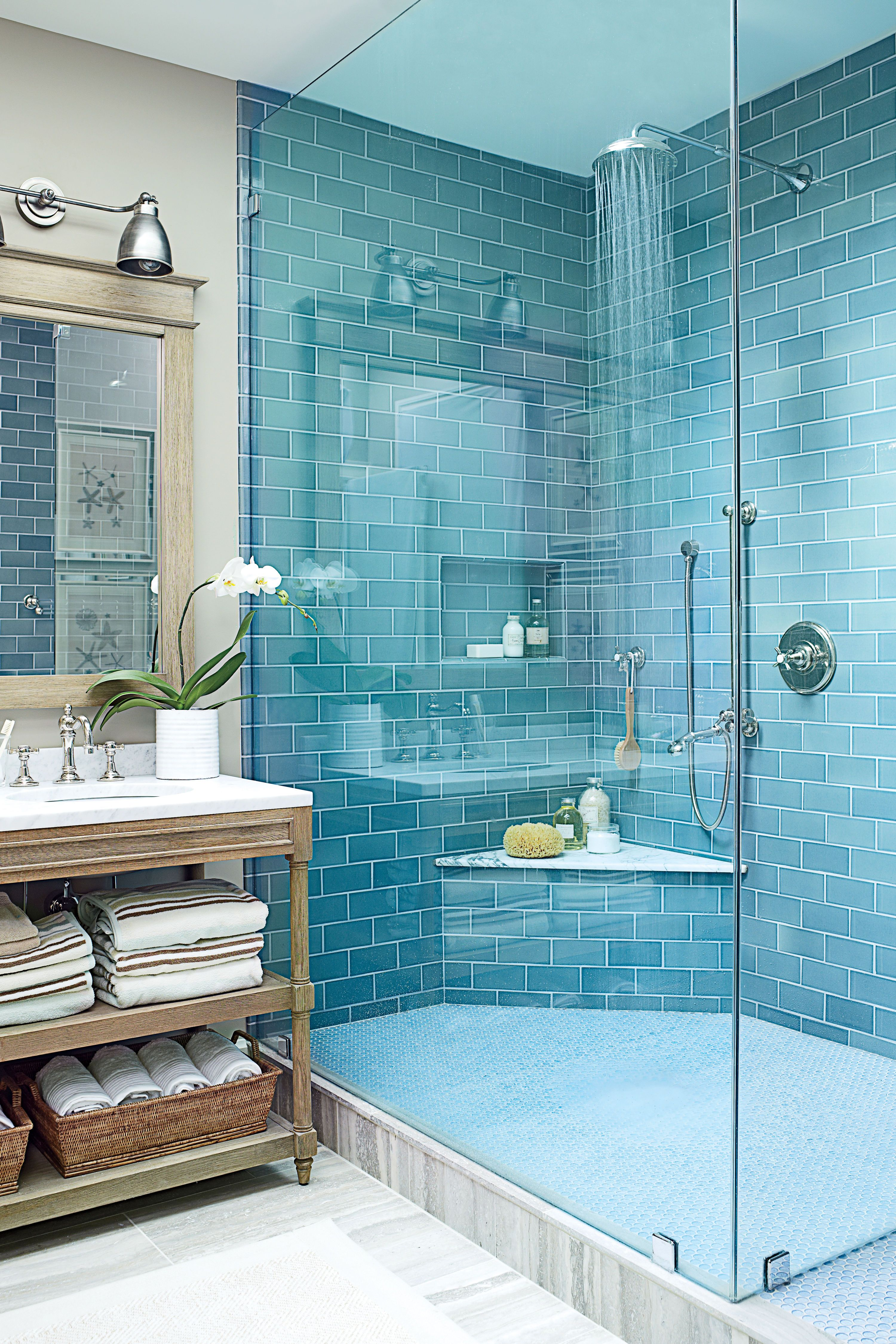 Beachy blue, glazed subway tile (from Waterworks) are the main event ...