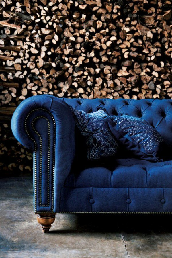 Stacked Firewood | Wood Texture | Nailhead Trim | Blue Chesterfield Sofa |  Iconic Furniture | Tufted Couch | Interior Design