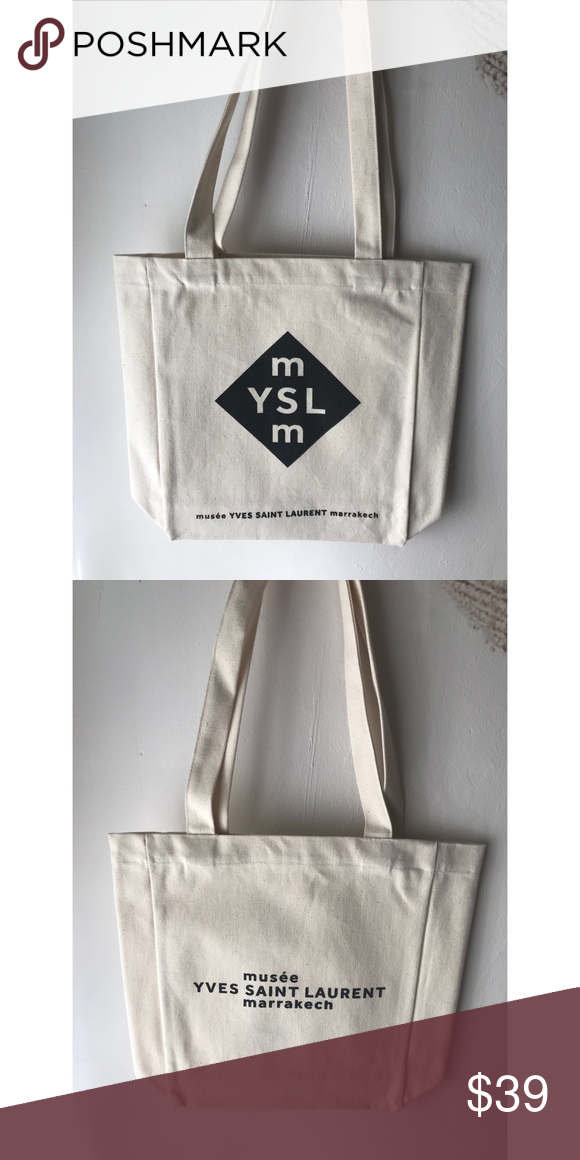 """4bf611a01c982 NWOT YSL Museum Canvas Tote New, never used shoulder tote purchased from  the Yves Saint Laurent Museum in Marrakech, Morocco. Cotton canvas,  12.5x14x3.5"""" ..."""