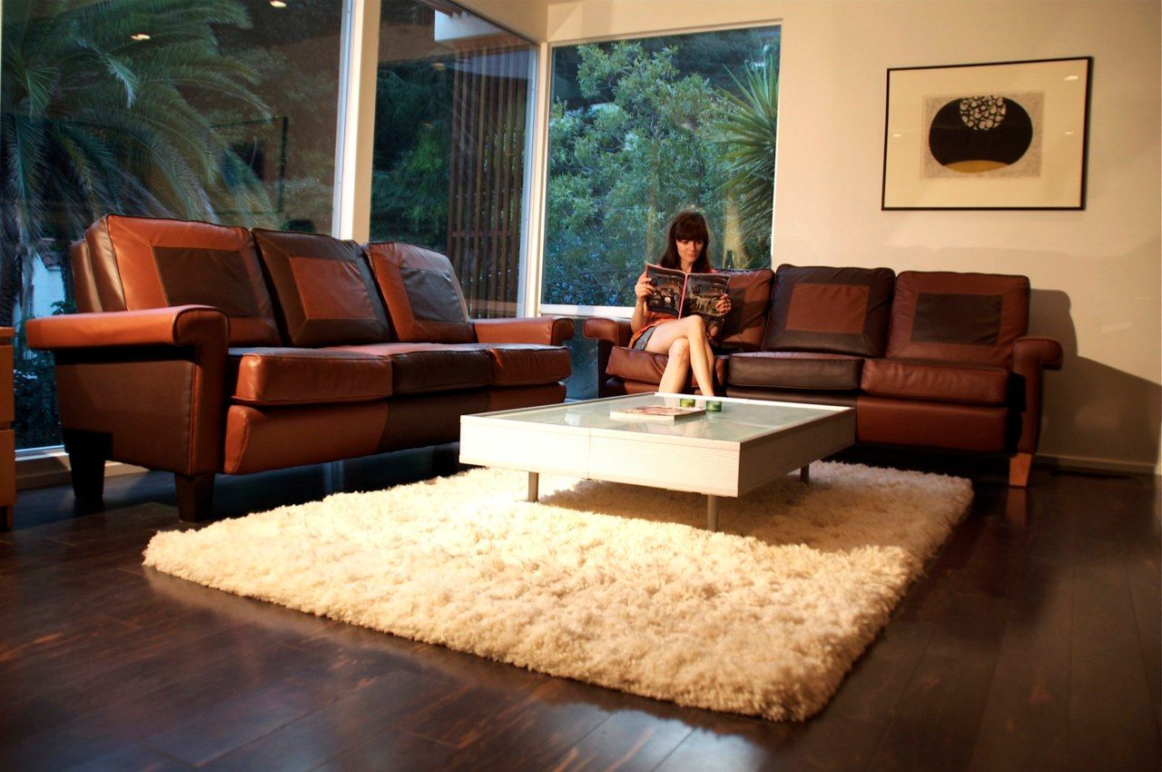 Gorgeous Brown Couch and Creme Rug Is Lovely in This Unit It. Leather Living Room Furniture. Living Rooms with Leather Sofas Furniture Axiom Leather Living. Leather Couch Living Room Design Decor On Homey Inspiration For