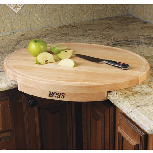 John Boos Corner Cutting Board This hard-rock maple board converts a counter corner space into efficient working space.