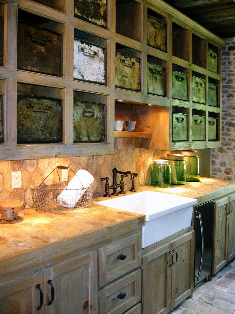 Handrubbed whitewashed cabinets a farm style sink and tin baskets