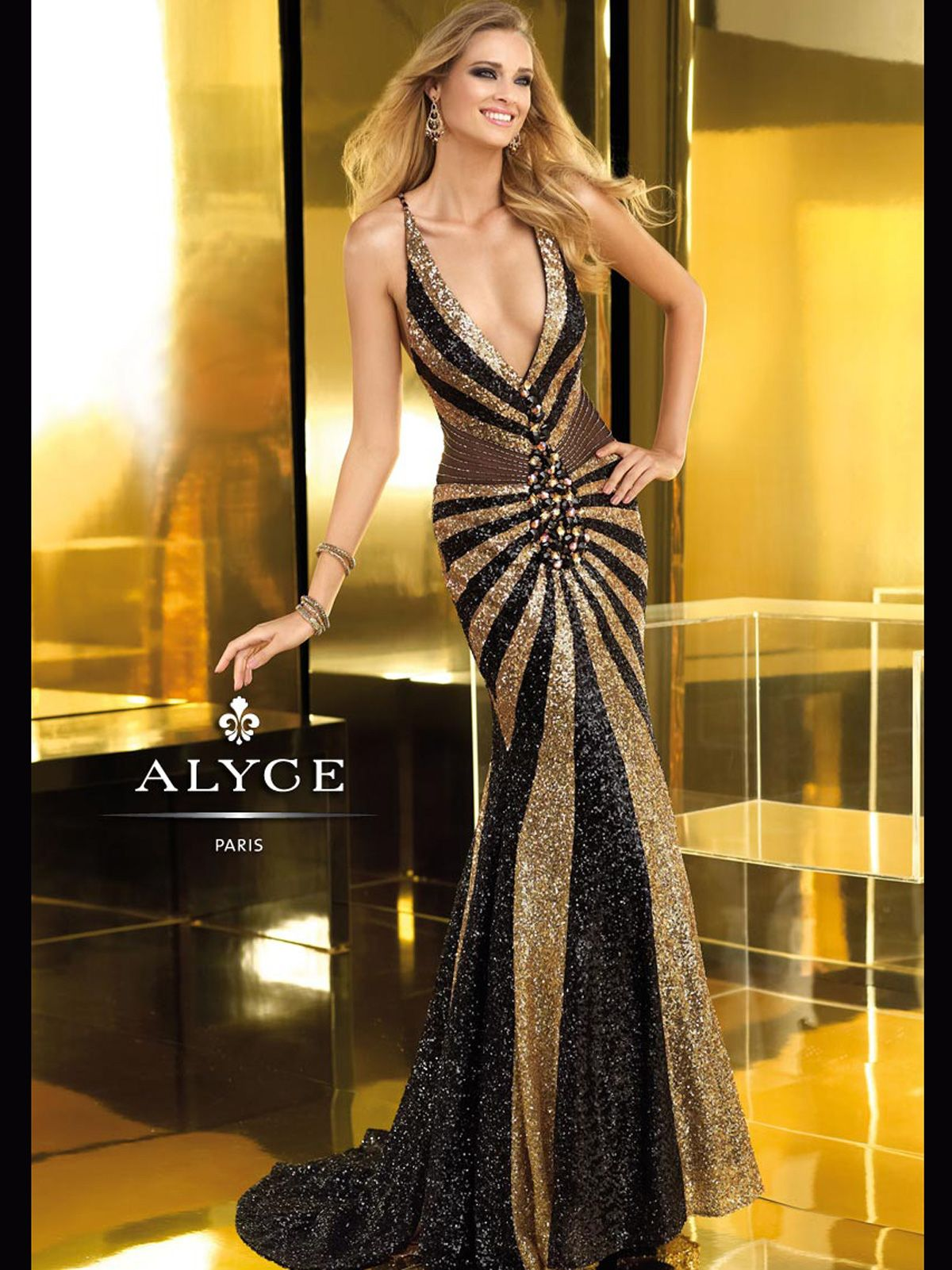 35a615298d This plunging deep V neckline Claudine prom dress 2211 features a black and  gold color blocked pattern that is made up of sequin fabric.