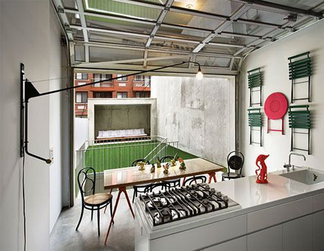 Charming The Kitchen In This East Village Triplex Has A Retractable Garage Door  Facade. The Glossy White Cabinets And Countertop, Vola Faucet And White  Walls Are ...