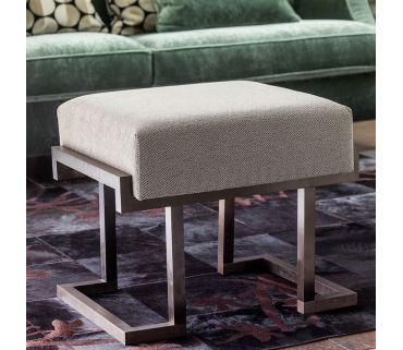 Between rationalism and Deco, the Parentesi stool is a unique fabric seat resting on a sturdy geometrical burnished brass base.