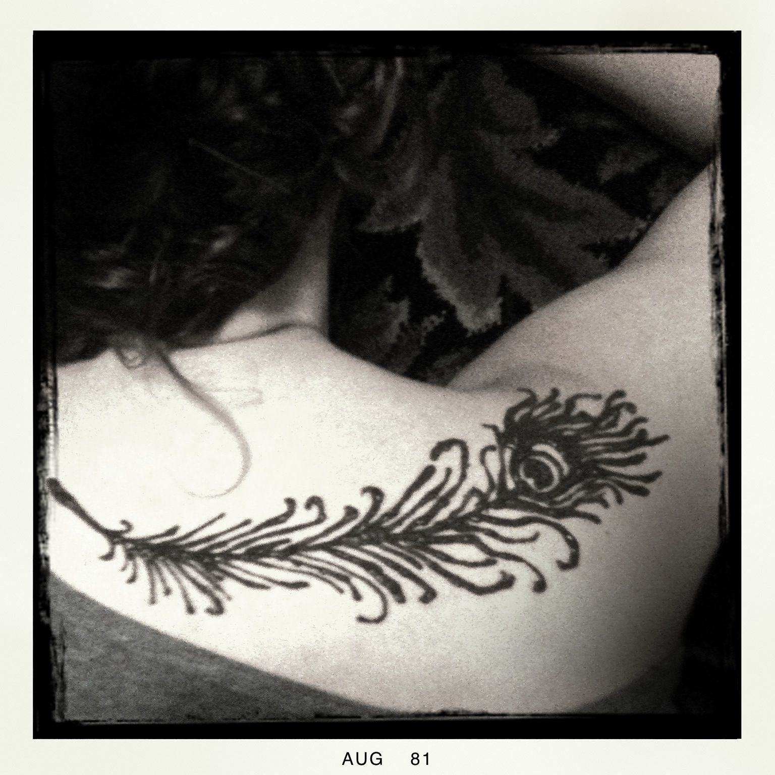 Henna Peacock Tattoo Lower Back: Peacock Feather Across Upper Back. Looks Really Cool