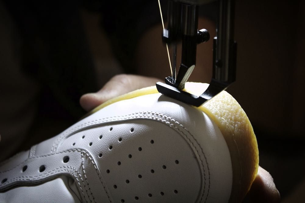 30222227b1  BehindTheScenes at the sole swap pop up - Stitching the customer s  handpicked crepe sole to an AF1 upper. by theshoesurgeon