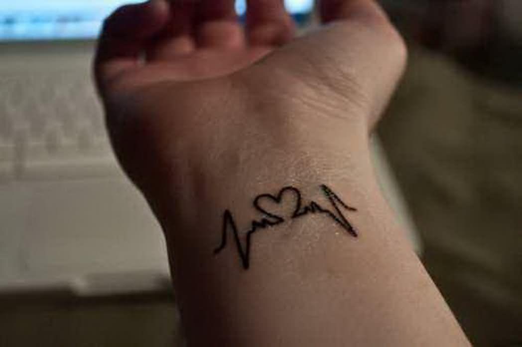 Henna Heartbeat With Heart Tattoo On Wrist Wrist Tattoos