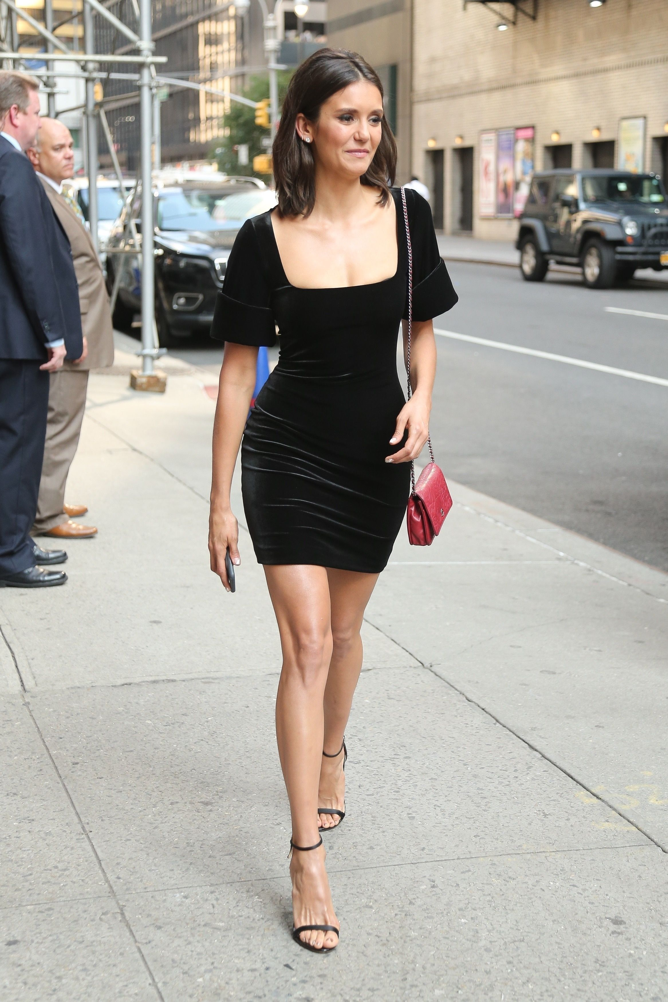 Nina Dobrev Wearing A Black Mini Dress While Leaving The