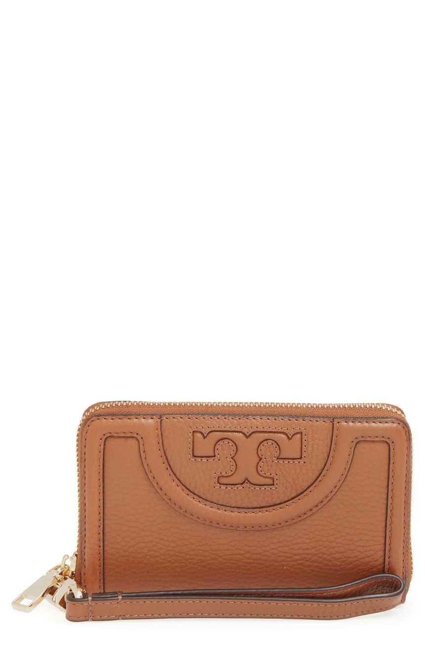 Free shipping and returns on Tory Burch 'Serif T' Leather Smartphone Wristlet at Nordstrom.com. An exquisitely stitched logo design lends signature sophistication to the front of a pebbled leather wristlet that's big enough to accommodate your iPhone 6 or 6s.