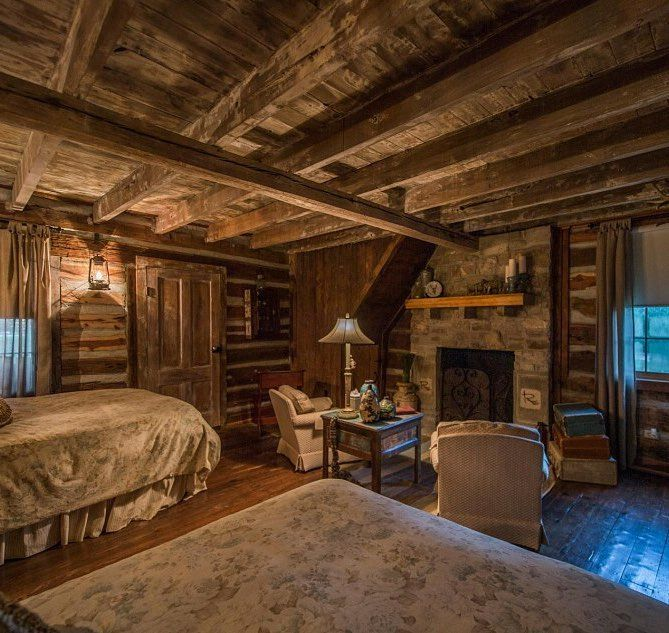Log Cabin Bedroom: Beautiful Log Cabin Bedroom With A Fireplace To Boot