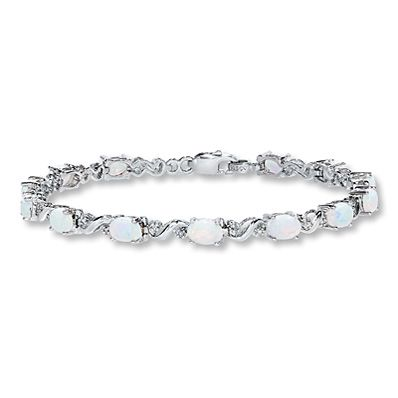 3dd5aa1ae Oval lab-created opals luminesce between diamond-accented curlicues of sterling  silver in this charming bracelet for her. The bracelet is secured with a ...